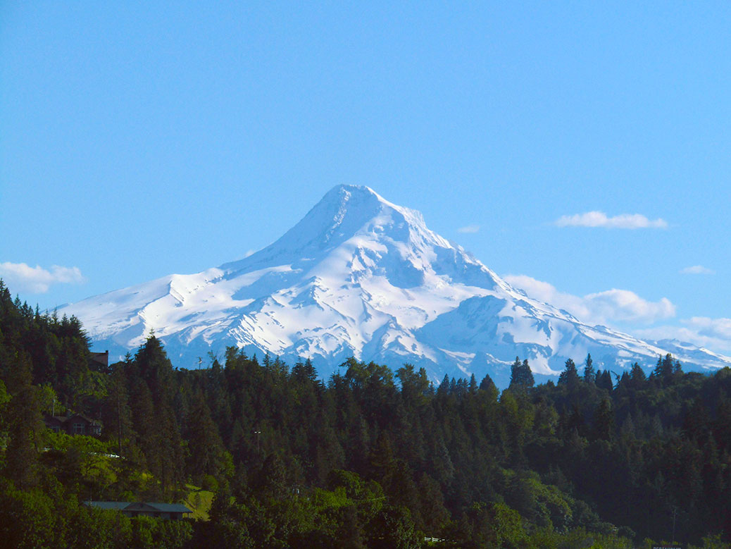 Looking at the northwest face of Mount Hood from the Hood River Bridge.
