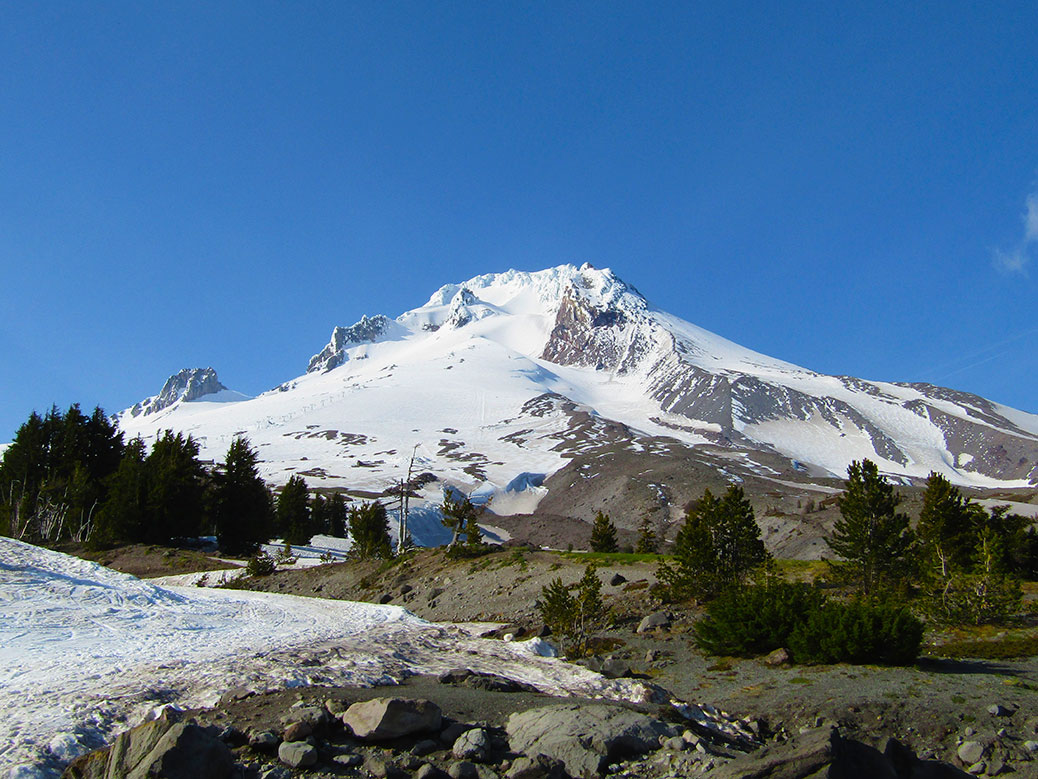 The summit of Mount Hood is mostly free of snow by mid-spring.