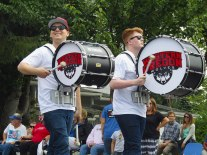 Members of the Western Oregon University drumline march in the 2016 Western Days Parade.
