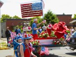 A local florist decked out a float in red, white and blue flowers.