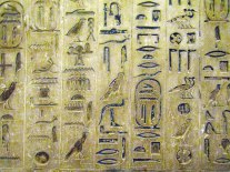More hieroglyphics from the Pyramid of Unas. The symbols that are encircled represent his name.