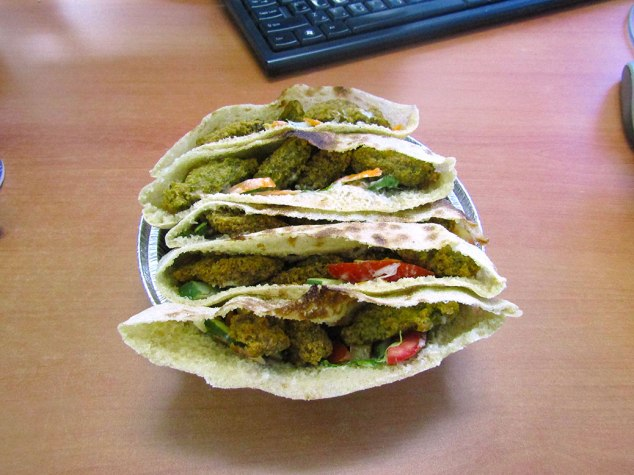 I accidentally ordered five falafel sandwiches from the school cafeteria. All ordering is done in Arabic and hand gestures. I thought I was ordering five falafel pieces. Needless to say, it all got eaten.