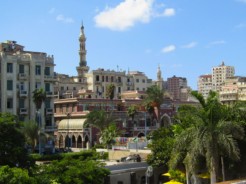 Blue skies and palm trees in Alexandria. And it wouldn't be Egypt without a couple of minarets!