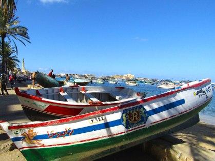Boats lining Alexandria's corniche, or waterfront promenade.