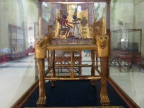 The wooden throne of Tutankhamun features an image of him under the sun ('Aten' for his birth name Tutankhaten) while his queen applies perfume on him.