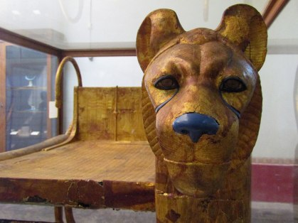 The third bed has a crying lion, grief stricken by his king's death.