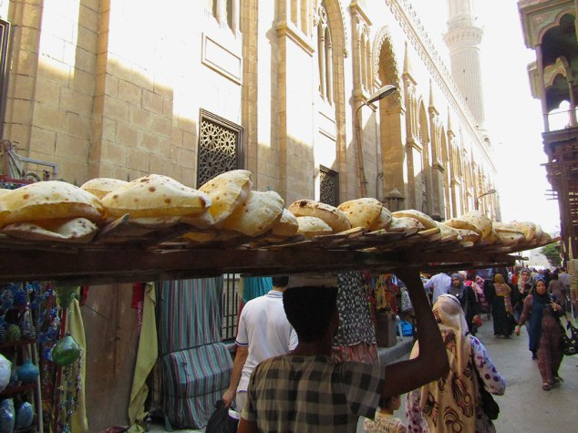 A baladi bread seller appeared behind us with a balancing act on his head!