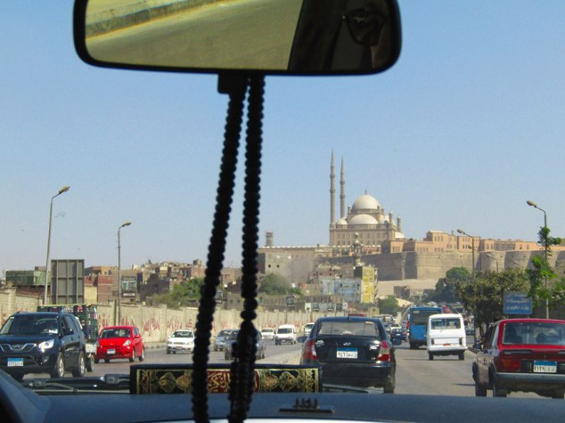 First glimpse of the mosque as it sits on top of the city. I believe there is a Holy Quran in the driver's car as well!