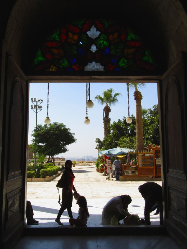 Walking out the door to views of the gardens and city of Cairo.