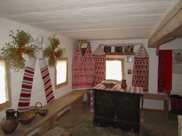 We were able to see into the interior of some of the homes. This is the kitchen and main living area. It has the traditional red embroidered linens and flowers and herbs drying on the walls.