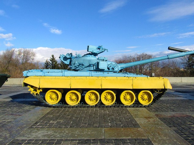 A military tank painted in the colors of Ukraine's flag, blue and yellow. The blue represents the sky and the yellow, fertile fields of wheat.