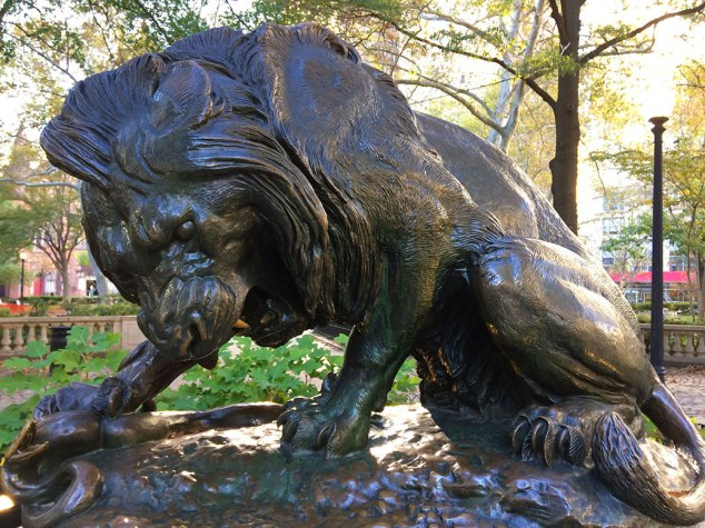 A statue of a lion squashing a snake in Rittenhouse Square, one of the original five public park spaces planned by William Penn in the late 1600s.