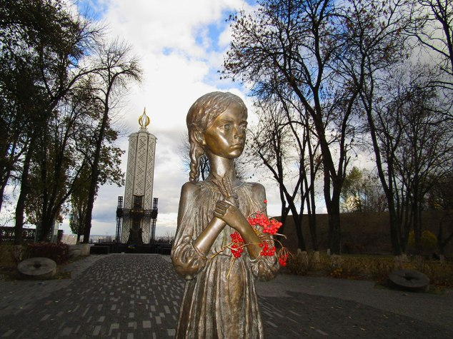 This statue, named the Bitter Memory of Childhood, is dedicated to the most vulnerable victims of starvation—children. The little girl is holding five stalks of wheat because that is all that was allowed. Picking up wheat left on the collective farm fields after harvest was considered a crime and was punishable by imprisonment or death.