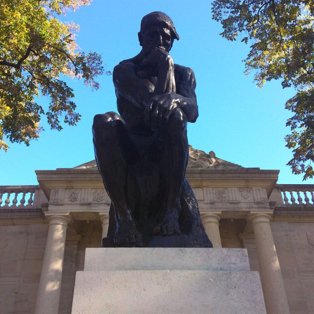 The Thinker sits outside Philadelphia's Rodin Museum. Casts of the statue exist around the world today. We saw the original two-foot tall version in Musee Rodin in Paris during our travels around Europe.